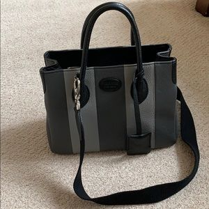 Suarez handbag- top handle and crossbody strap.